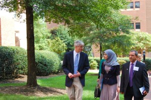 Kurt Gilliland, assistant dean of curriculum for the UNC School of Medicine, leads a tour of doctors from Iraq visiting UNC as part of a collaboration between UNC and the University of Baghdad's College of Medicine to enhance its curriculum. Photo by Mark Derewicz.
