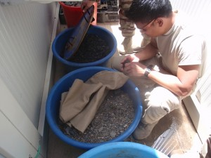 UNC Gillings doctoral student Major Jay Reyes creating a sand filter in Afghanistan.